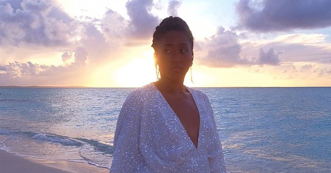 Naomi Osaka Dazzles As She Walks At Sundown Wearing a White Sequin Dress With a Deep Neckline