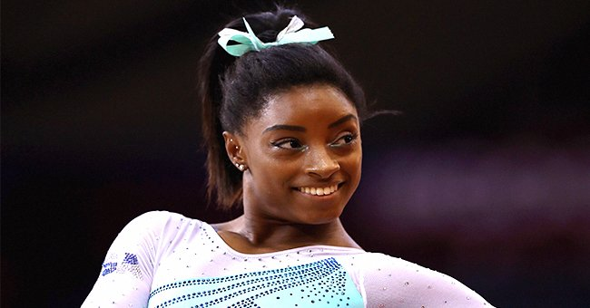 Check Out Simone Biles' White Smile as She Poses in a Grey Sweater and Cool Pants