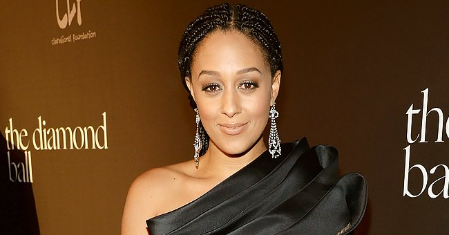 Tia Mowry Looks Unforgettable in a Brown Faux Leather Jumpsuit & Matching Belt — See Her Look