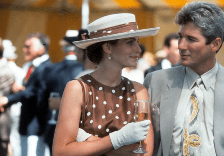 """Julia Roberts playing Vivian Ward at a polo match with Richard Gere on the set of """"Pretty Woman,"""" in 1990 
