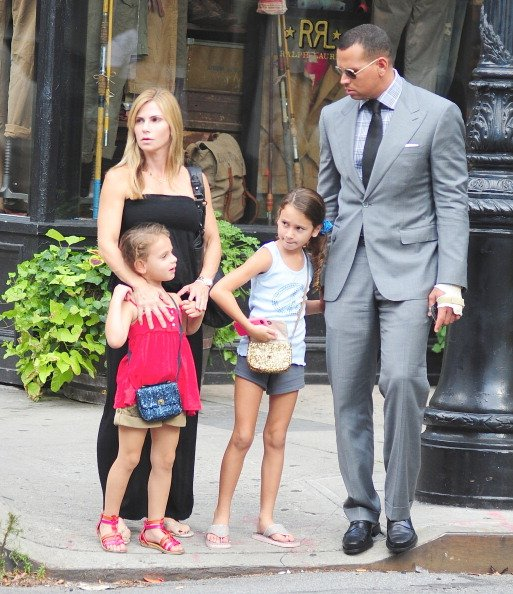 Alex Rodriguez and Cynthia Scurtis are seen with their daughters Ella Rodriguez and Natasha Rodriguez in the West Village on August 2, 2012 in New York City | Photo: Getty Images