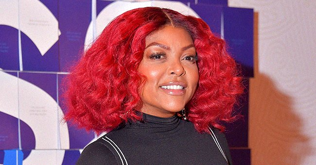 Taraji P Henson Stuns with Pink Hair as She Poses in a Stylish White Jacket & Tight Jeans