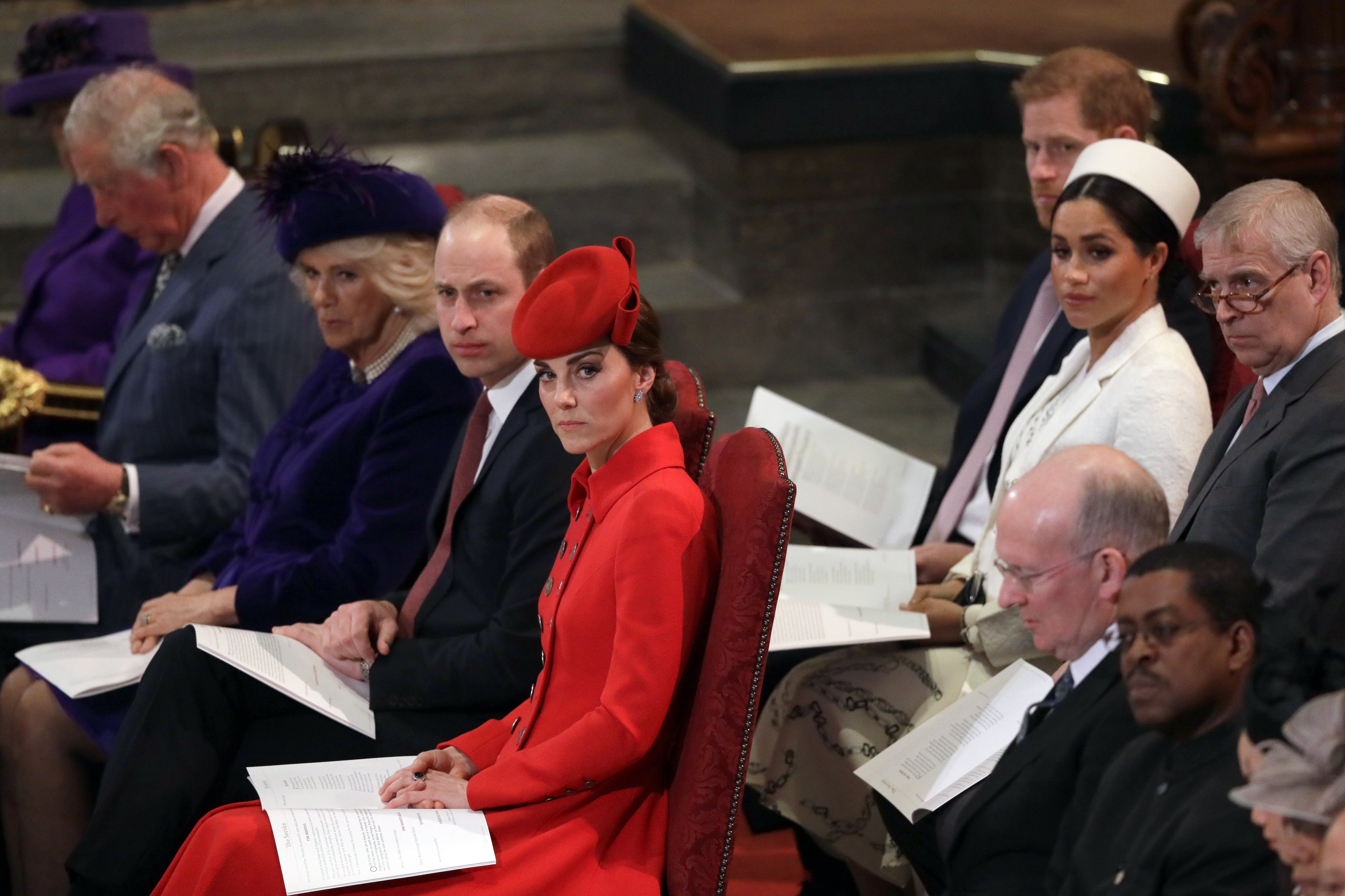 Kate Middleton and Meghan Markle with Prince William, Prince Harry, Camilla Parker-Bowles, Prince Charles and Prince Andrew at the Commonwealth Service at Westminster Abbey in London, England | Photo: Getty Images