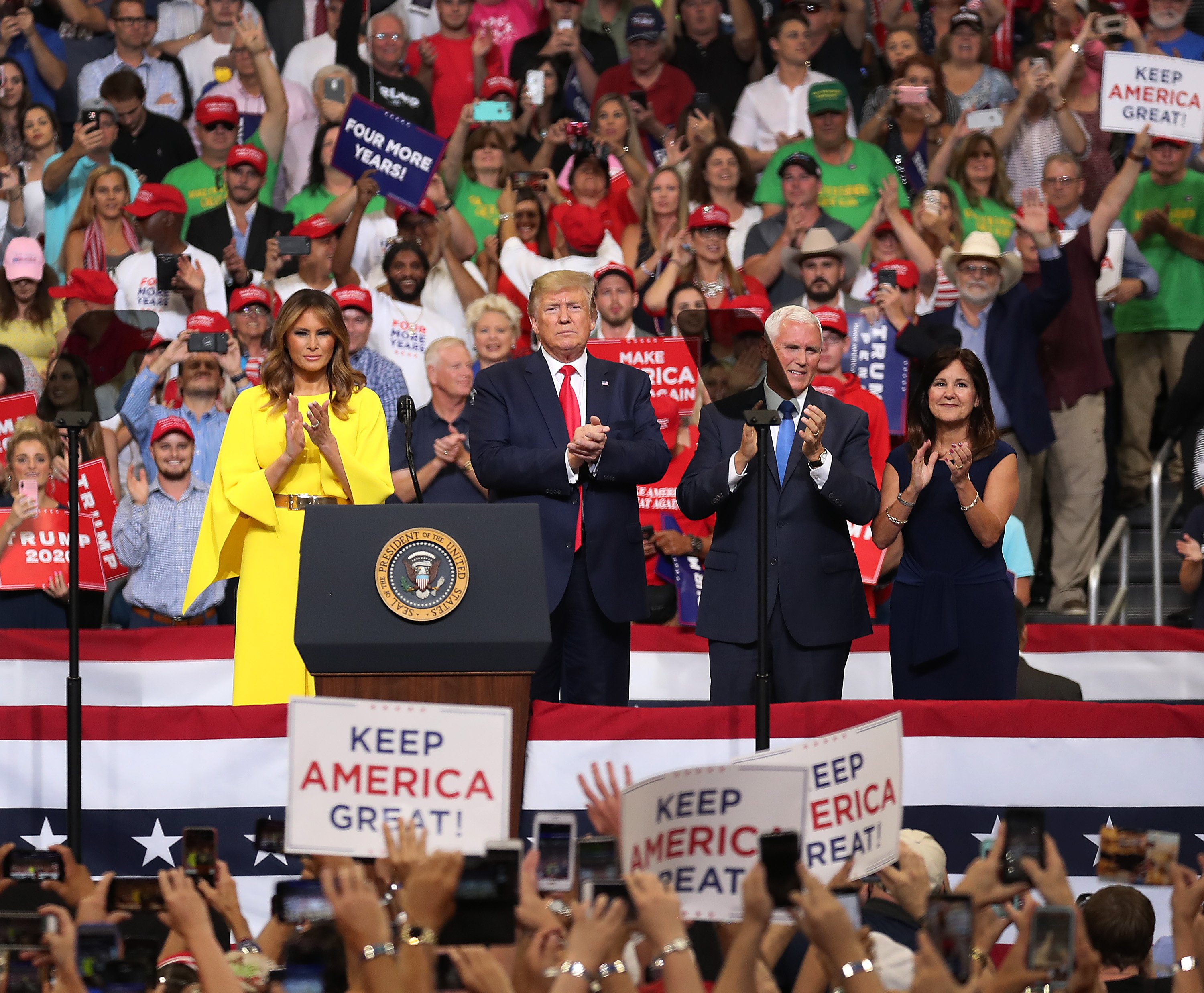 Donald Trump, Melania Trump, Mike Pence and his wife, Karen Pence, at the Amway Center in Orlando, Florida | Photo: Getty Images
