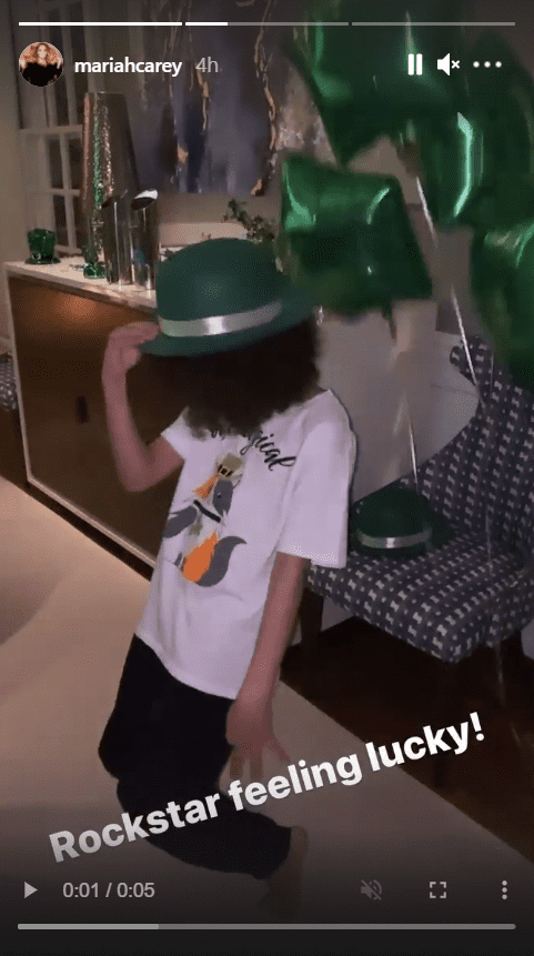 Mariah Carey's son, Moroccan Scott, seen donning a green hat while dancing | Photo: Instagram/mariahcarey