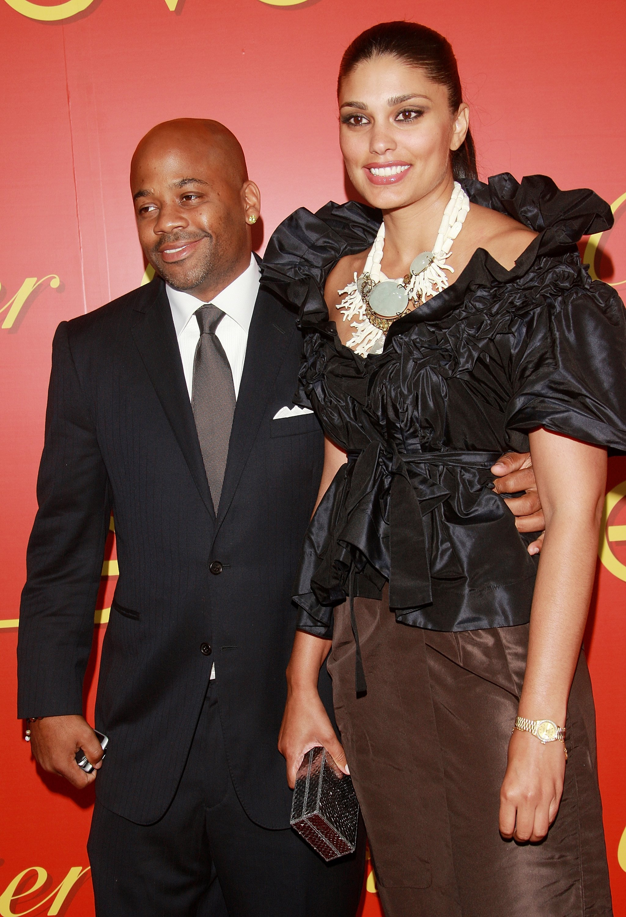 Damon Dash and Rachel Roy attend a cocktail party in celebration of The Cartier Charity Love Bracelet at The Cartier Mansion, June 7, 2007, in New York City. | Source: Getty Images.