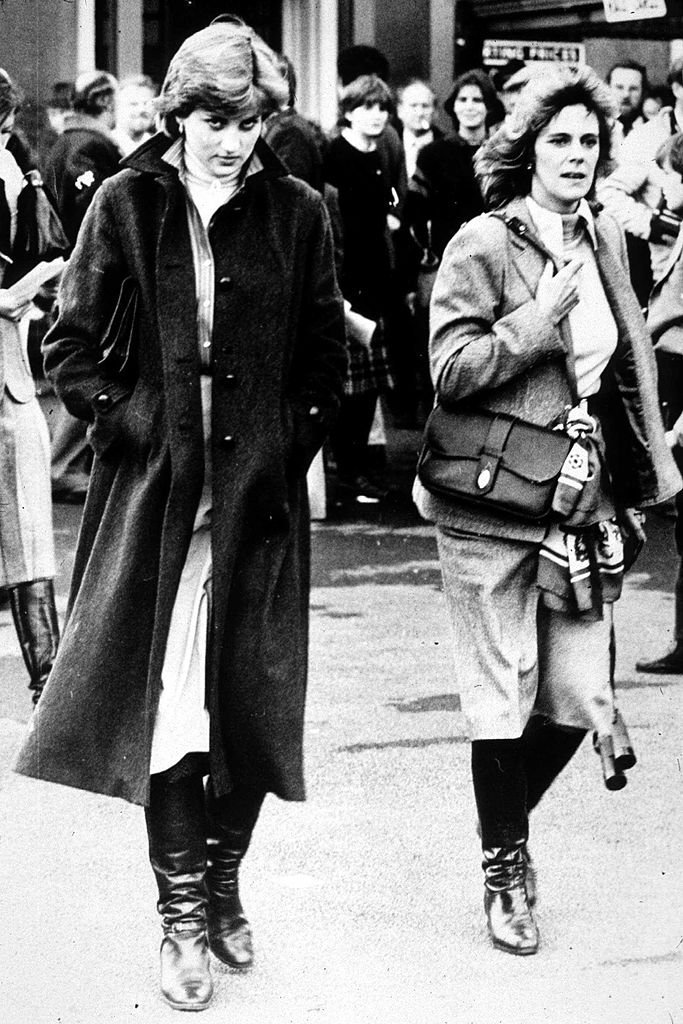 Lady Diana Spencer and Camilla Parker-Bowles at Ludlow Races where Prince Charles is competing, 1980. | Photo: GettyImages