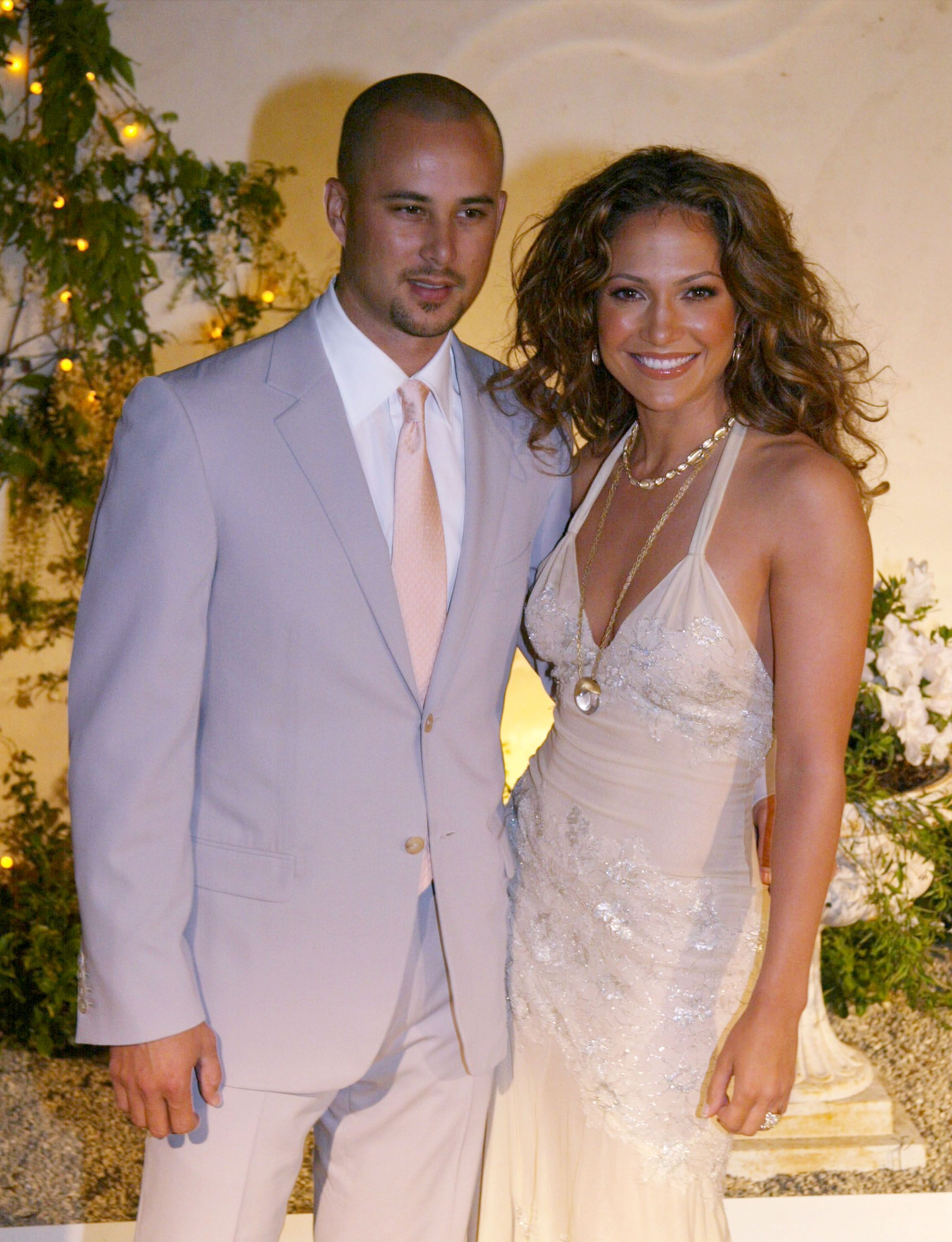 Jennifer Lopez and ex-husband Cris Judd at the opening of her restaurant, Madres, in Pasadena in 2002 | Source: Getty Images
