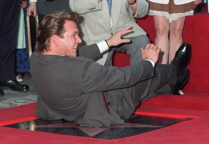 Patrick Swayze sits on his Hollywood Walk of Fame star | Photo: Getty Images