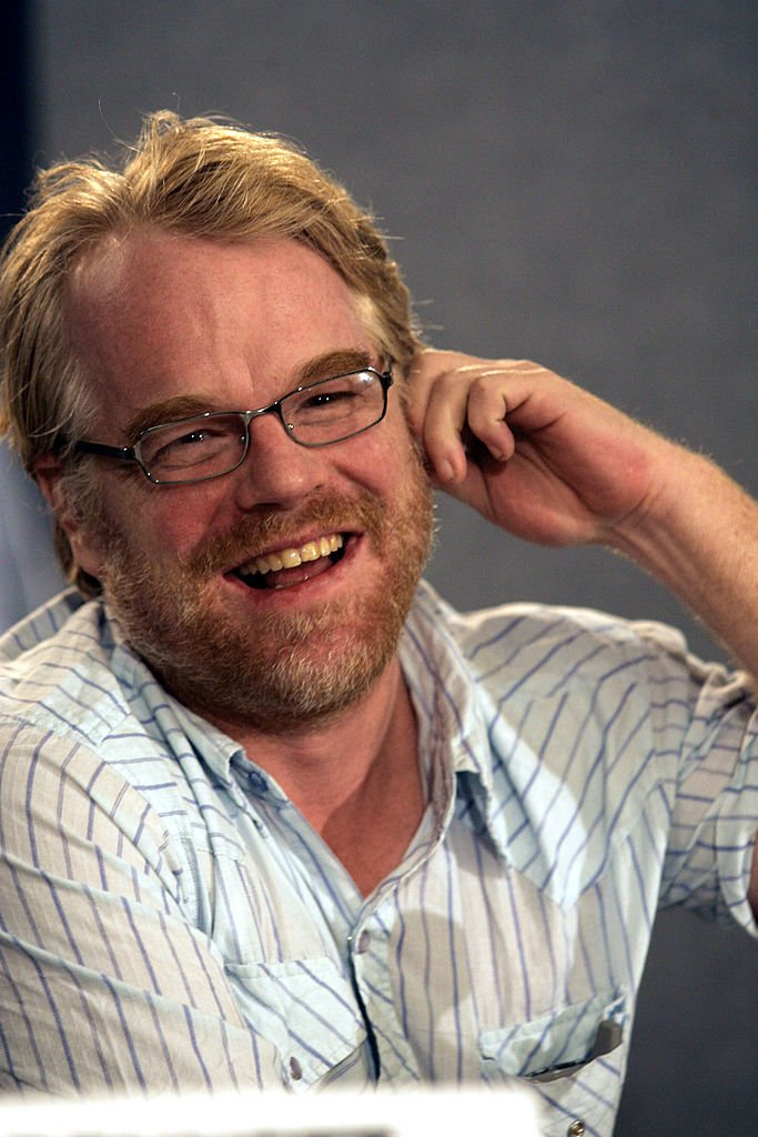 """Philip Seymour Hoffman gestures as he attends a media conference at the Toronto International Film Festival for the film """"Capote"""" on September 11, 2005 