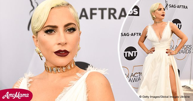 Lady Gaga rocks cleavage-baring white dress, flaunting her legs through a racy thigh-high split