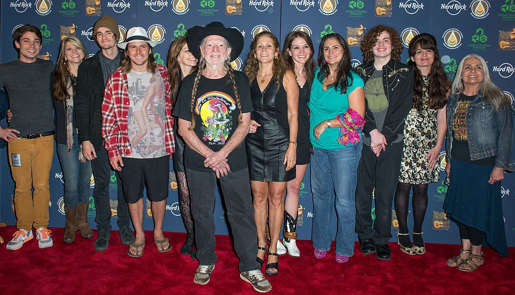 Trevor Nelson, Paula Nelson, Jacob Micah Nelson, Lukas Nelson, Amy Nelson, Willie Nelson, Annie D'Angelo, Raelyn Nelson, Rachel Fowler, Dean Hubbard, Martha Fowler, and Lana Nelson attend Hard Rock International's Wille Nelson Artist Spotlight Benefit Concert at Hard Rock Cafe, Times Square on June 6, 2013. Image Credit: Getty Images