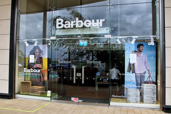 Barbour logo seen at one of their branches in United Kingdom. | Photo: Getty Images