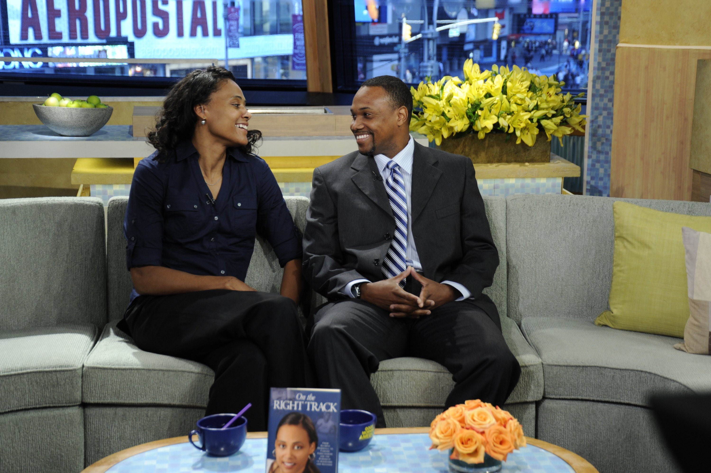 """Marion Jones talks about her new book, """"On the Right Track,"""" with her husband Obadele Thompson on """"Good Morning America"""" on October 26, 2010 