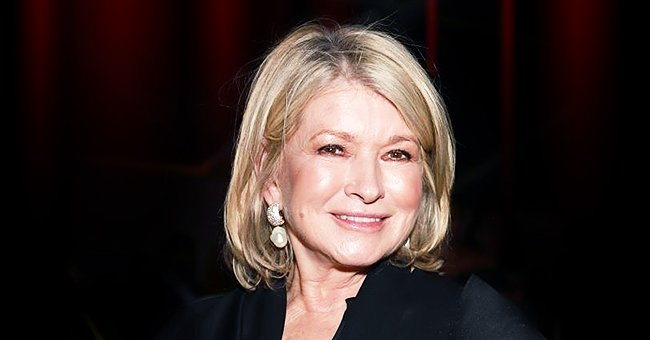 Martha Stewart Stacks Wine Glasses While Dining at a Restaurant in Photos