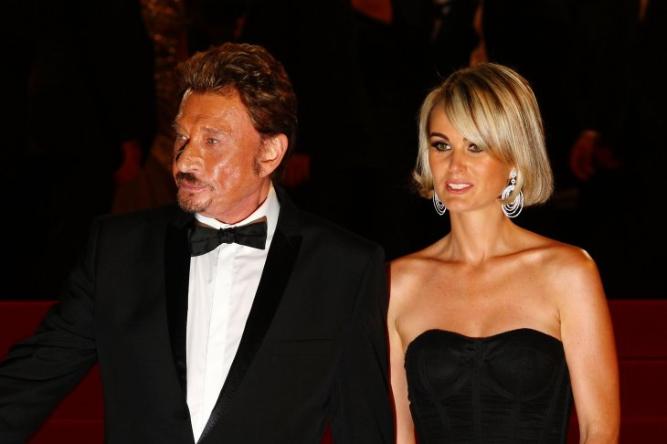 Laeticia Hallyday accompagnée de johnny Hallyday | Photo : Getty Images