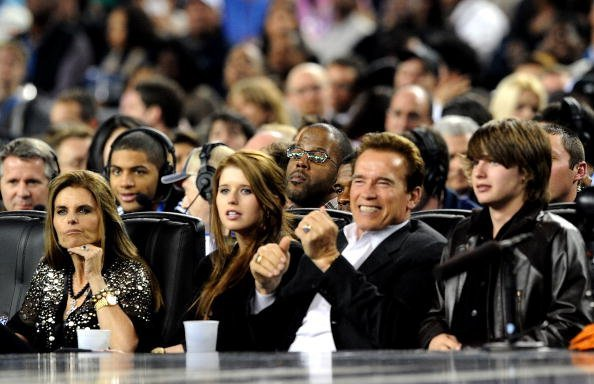 Maria Shriver, Christina Schwarzenegger, Governor of California Arnold Schwarzenegger and Patrick Schwarzenegger in the audience during the NBA All-Star Game held at Cowboys Stadium on February 14, 2010, in Arlington, Texas. | Source: Getty Images.