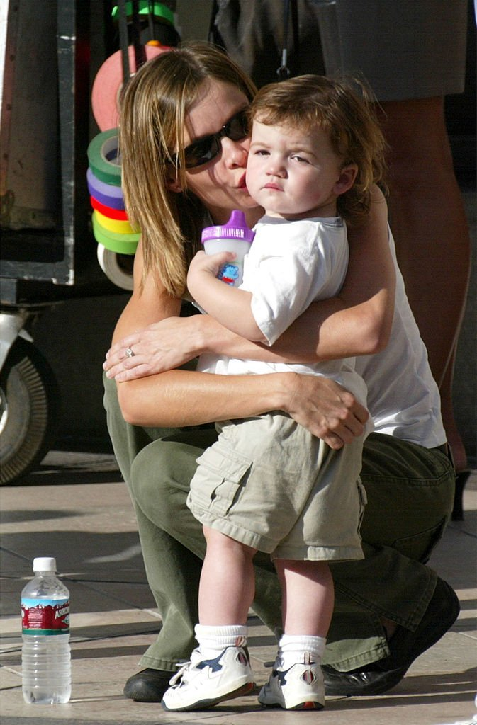 "Actress Calista Flockhart kisses her son, Liam, on the set of her boyfreind, actor Harrison Ford's upcoming movie, ""Two Cops"" on Rodeo Drive 