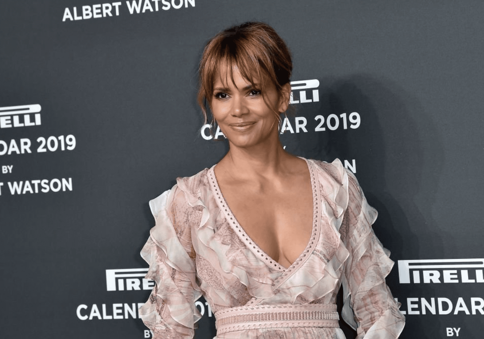 Halle Berry on the red carpet ahead of the 2019 Pirelli Calendar launch gala at HangarBicocca on December 5, 2018. | Source: Getty Images