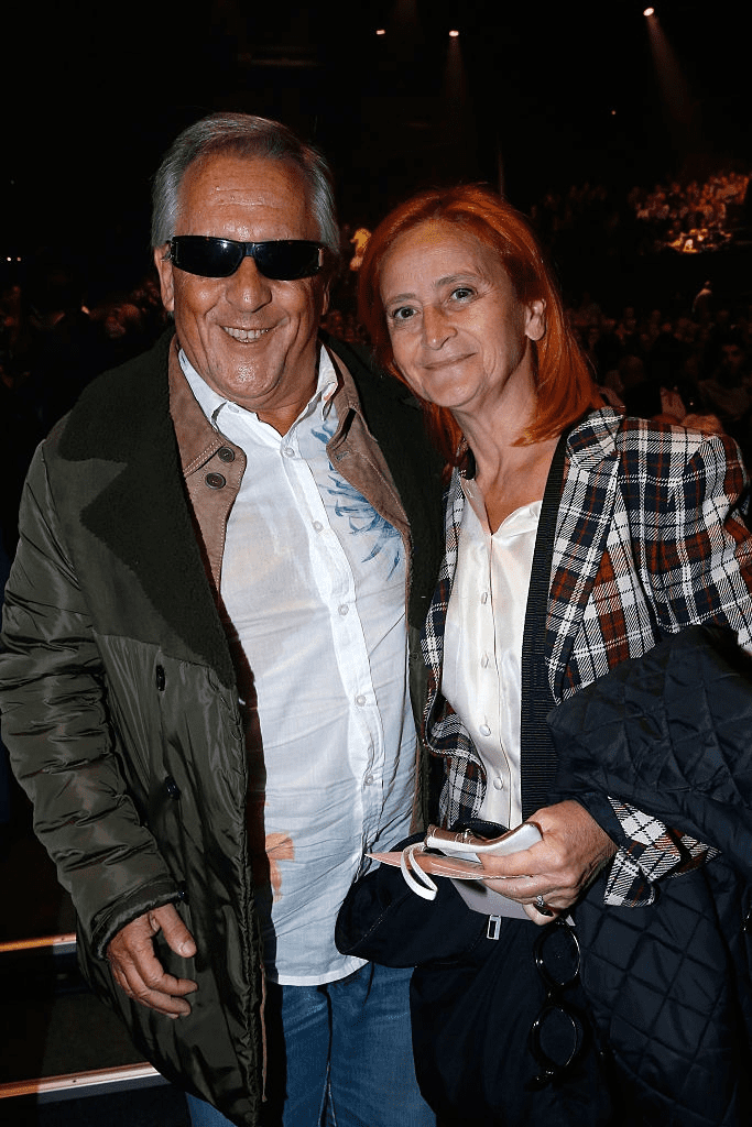 Le chanteur Gilbert Montagné et son épouse Nikole assistent au concert du chanteur Charles Aznavour au Palais des Sports le 15 septembre 2015 à Paris, France. | Photo : Getty Images