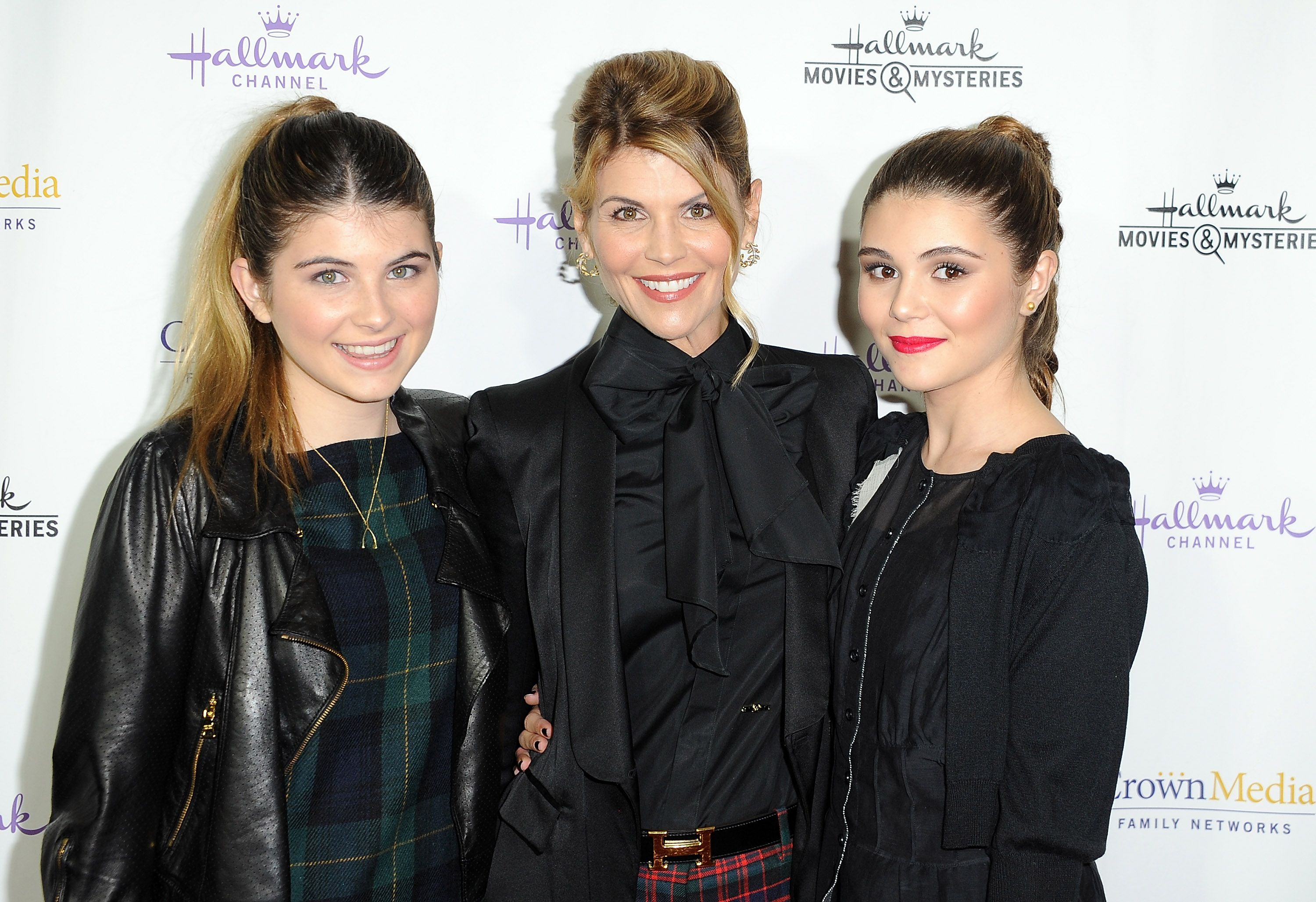 """Lori Loughlin and her daughters Isabella and Olivia Jade Giannulli at the premiere of """"Northpole"""" in 2014 in Los Angeles   Source: Getty Images"""