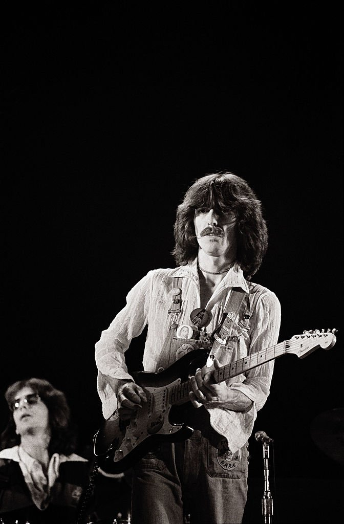 "Singer/songwriter and former Beatles member, George Harrison (R) and band memeber, keyboardist Billy Preston perform on stage during their ""North American Tour"" at the Capitol Center  