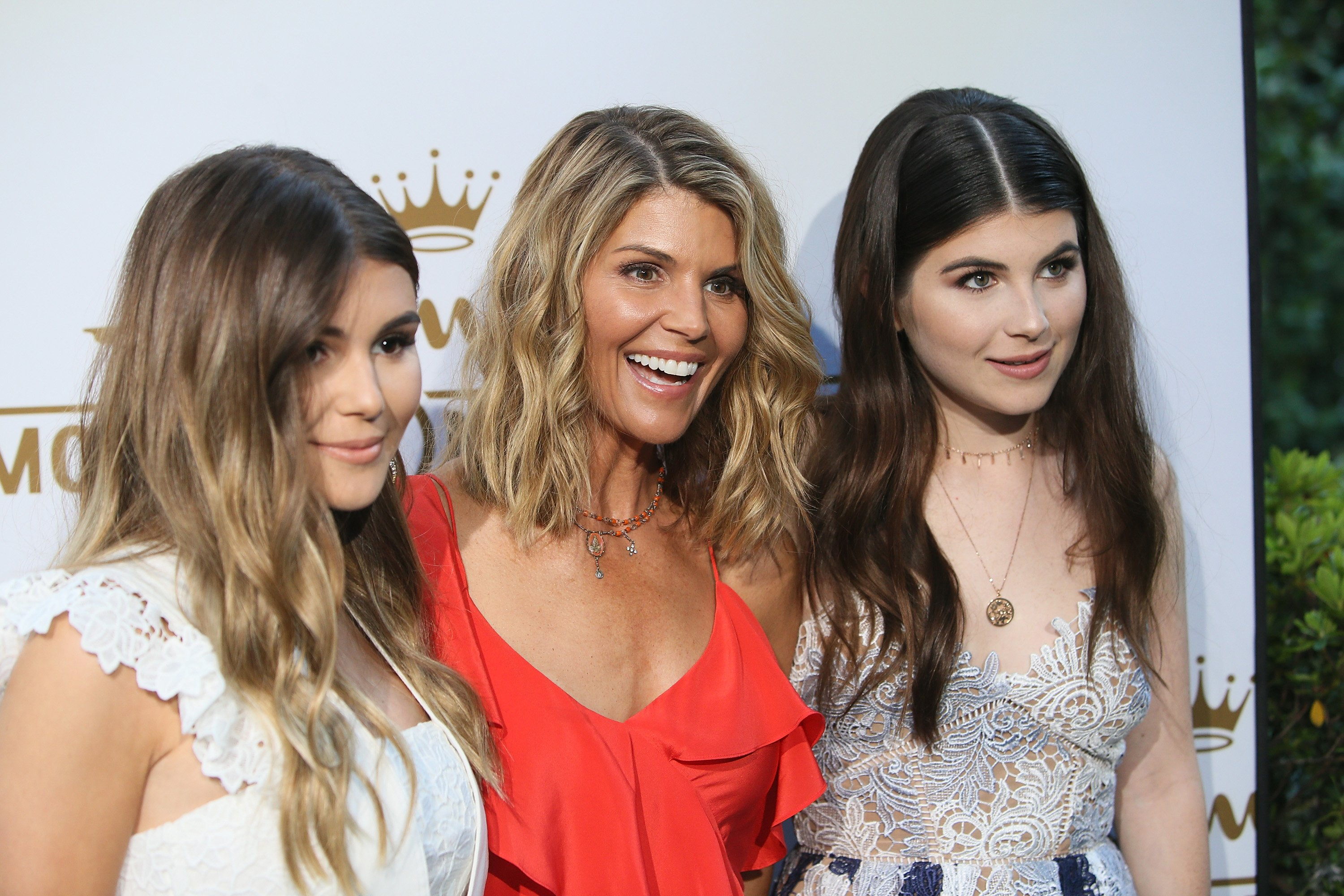 Lori Loughlin with daughters Isabella Rose and Olivia Jadei at the Hallmark Channel and Hallmark Movies and Mysteries 2017 Summer TCA Tour   Photo: Getty Images