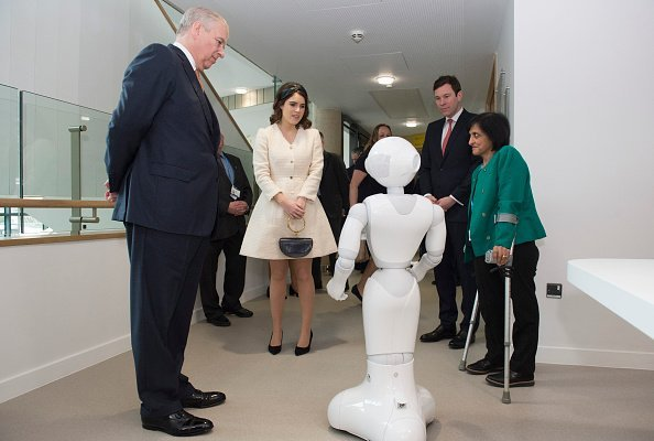 Prince Andrew, Princess Eugenie, Jack Brooksbank, and Dr. Saroj Patel with a robot called Pepper, during a visit to the Royal National Orthopaedic Hospital on March 21, 2019, in Stanmore, Greater London.| Source: Getty Images