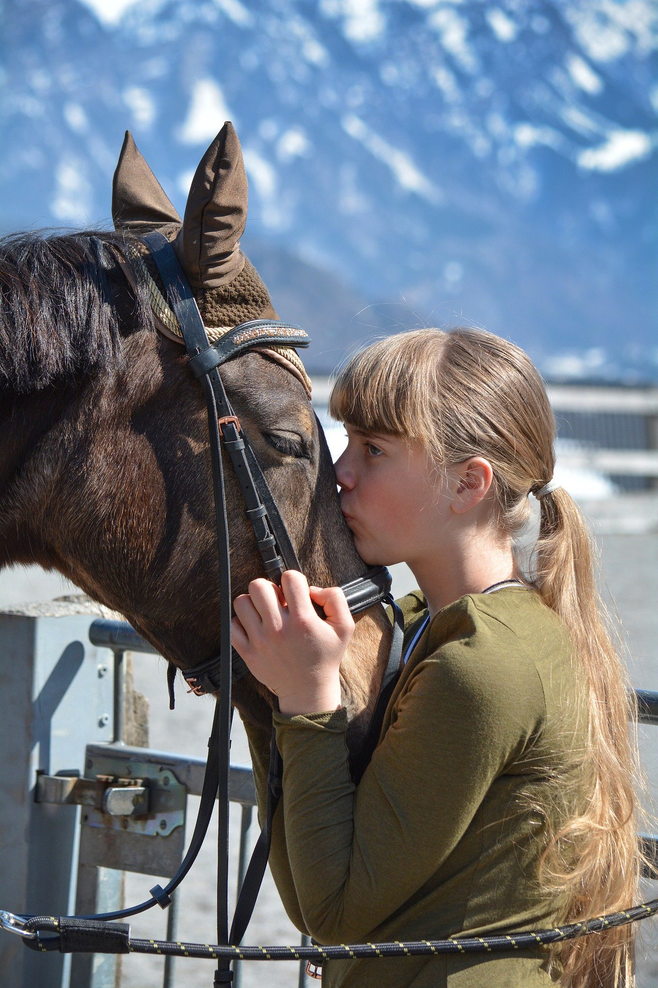 Pictured - An equestrian and kissing a horse   Source: Pixabay