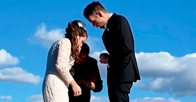 Andrew and Marlee Kent reacting to the ring falling off the pier during their wedding ceremony | Photo: Getty Images