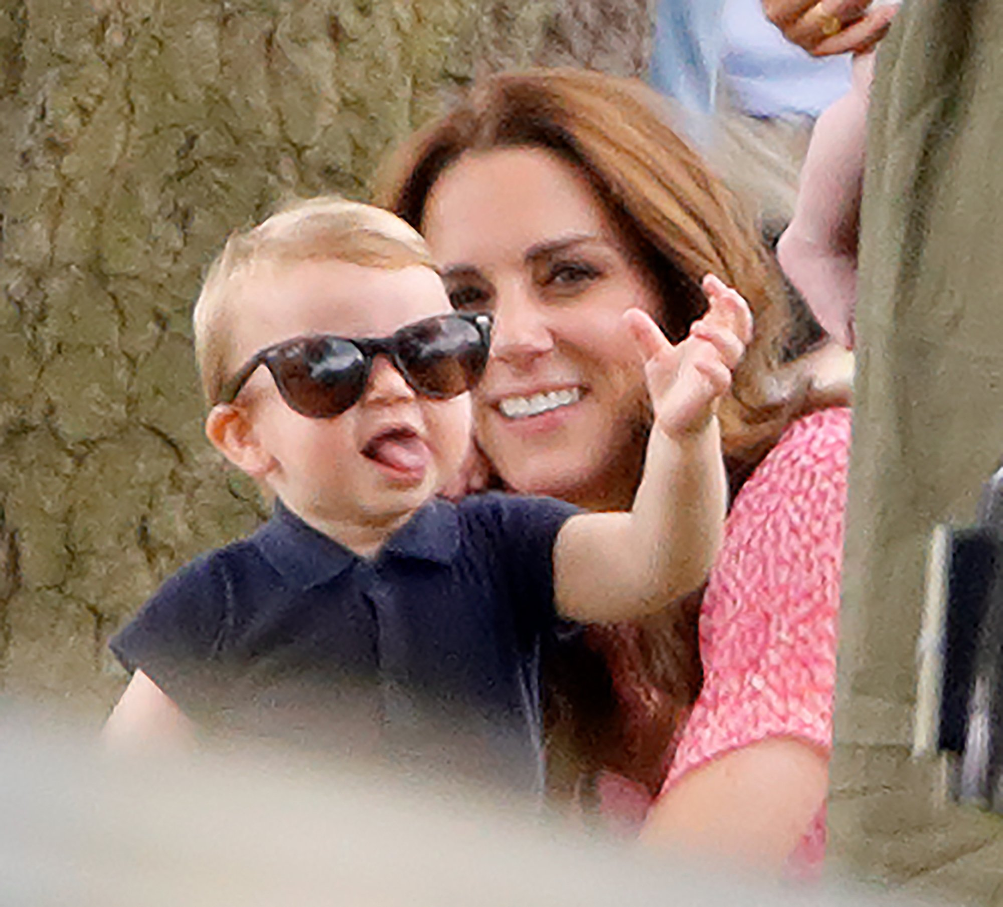 Prince Louis wears his mother's sunglasses at a charity polo match in July 2019 | Photo: Getty Images