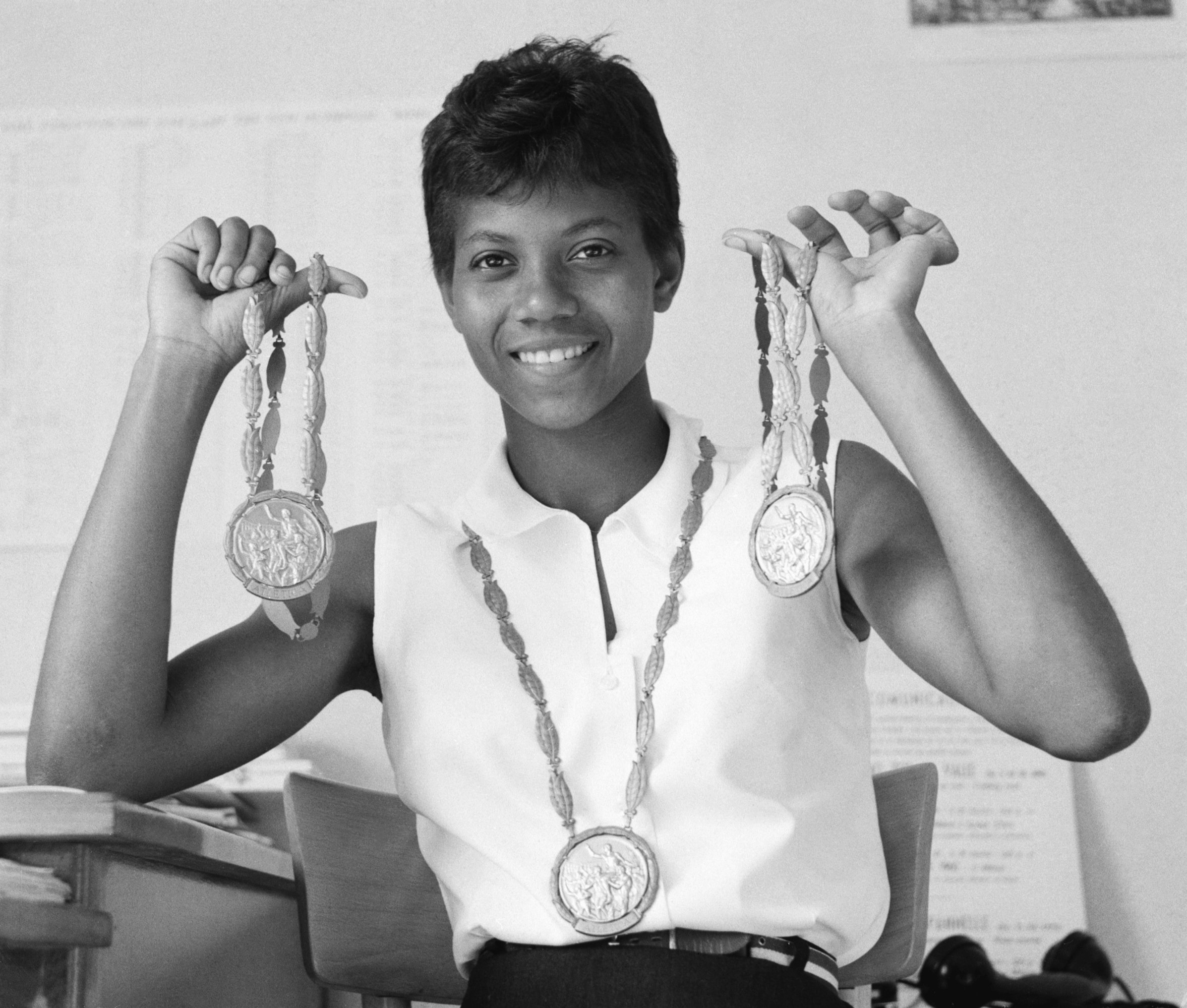 Wilma Rudolph shows off the three gold medals she won at the 1960 Olympics in Rome on September 8, 1960   Photo: Getty Images