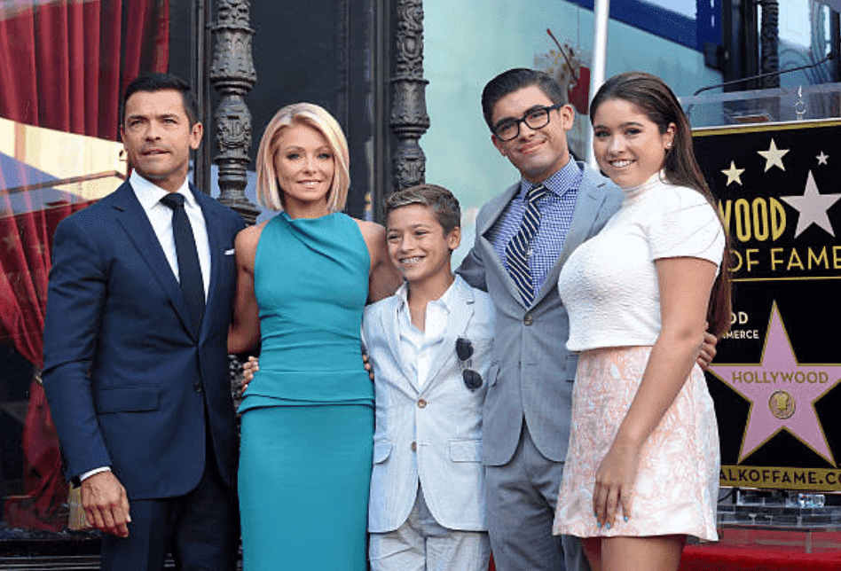 Kelly Ripa, Mark Consuelos their children Lola Consuelos, Michael Consuelos and Joaquin Consuelos pose for camera's at the ceremony for Kelly Ripa's star on the Hollywood Walk of Fame, on October 12, 2015, in Hollywood, California | Source: Getty Images