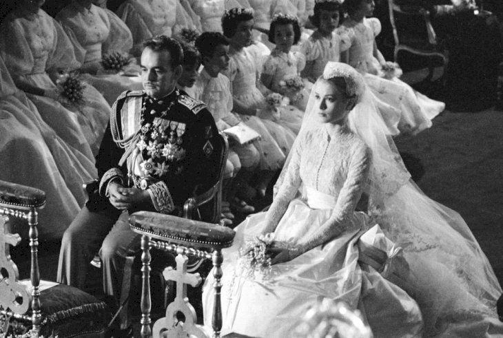 Prince Rainier of Monaco and American actress Grace Kelly (1929 - 1982) sit before the altar during their wedding ceremony at the Cathedral of Saint Nicholas, Monte Carlo, Monaco, April 19, 1956. Kelly's gown was designed by costume designer Helen Rose. (Photo by Thomas McAvoy/The LIFE Picture Collection via Getty Images)