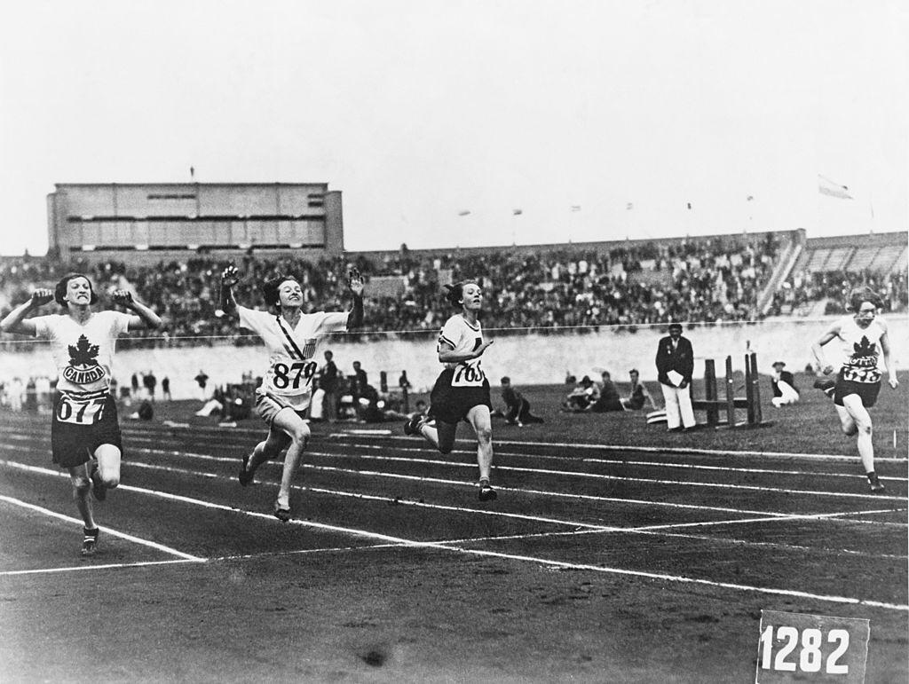 American athlete Betty Robinson (second from left) wins the final of the women's 100 Metres event during the Olympic Games at the Olympic Stadium, Amsterdam on July 31, 1928.   Photo: Getty Images