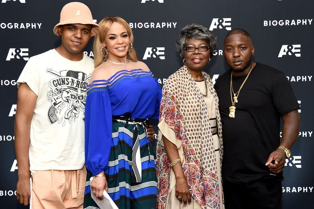 """Faith Evans with her son with the Notorious B.I.G., CJ Wallace and his mother, Voletta Wallace, and entourage member,  Lil' Cease at the screening of A&E's """"Biography Presents: Biggie: The Life of Notorious B.I.G."""" in August 2017. 