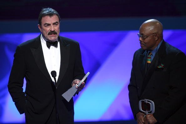 "Tom Selleck and Roger E. Mosley accept the Hero Award for ""Magnum P.I."" onstage at the 7th Annual TV Land Awards held at Gibson Amphitheatre on April 19, 2009, in Universal City, California. 