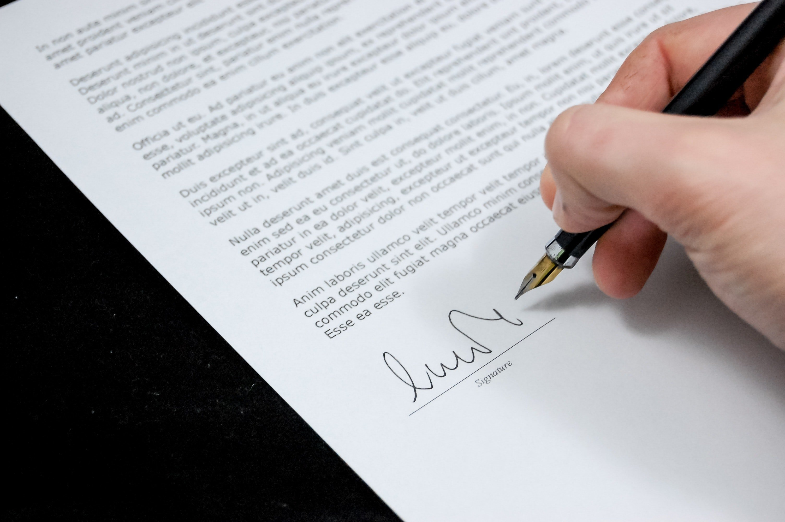 A signed document | Source: Pexels