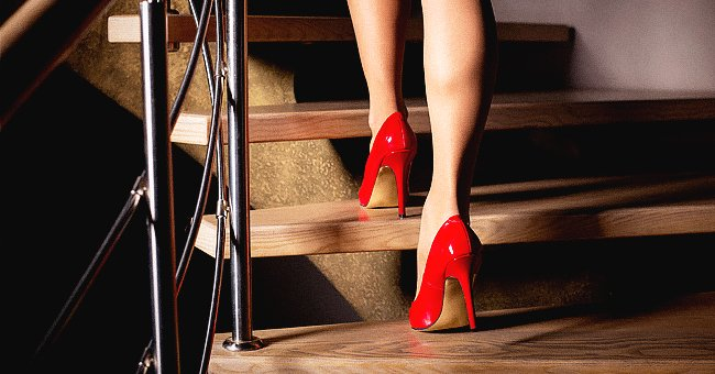 Woman walking down the stairs with heels on   Source: Shutterstock