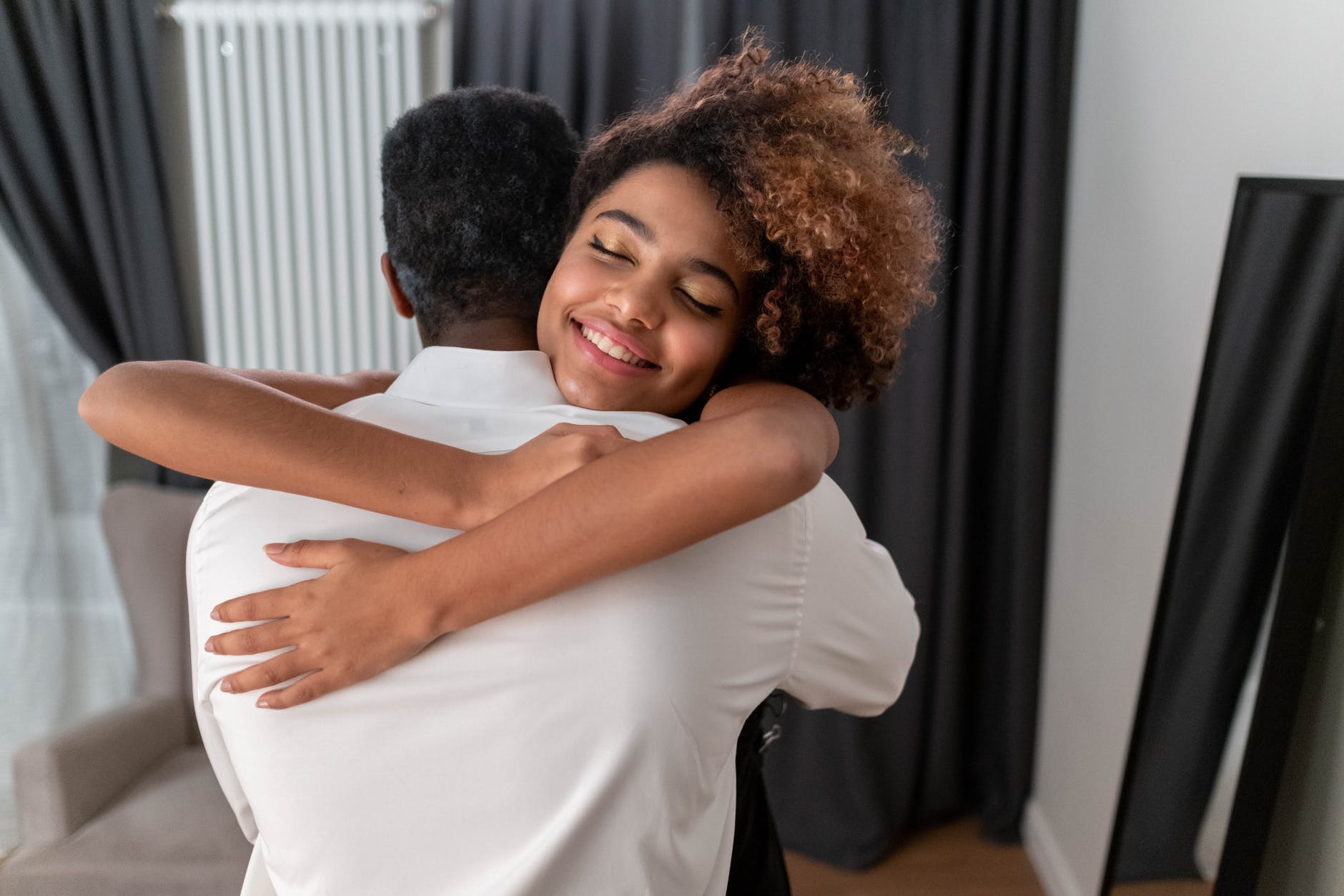 Alice hugged her dad and was never ashamed of him again.   Source: Pexels