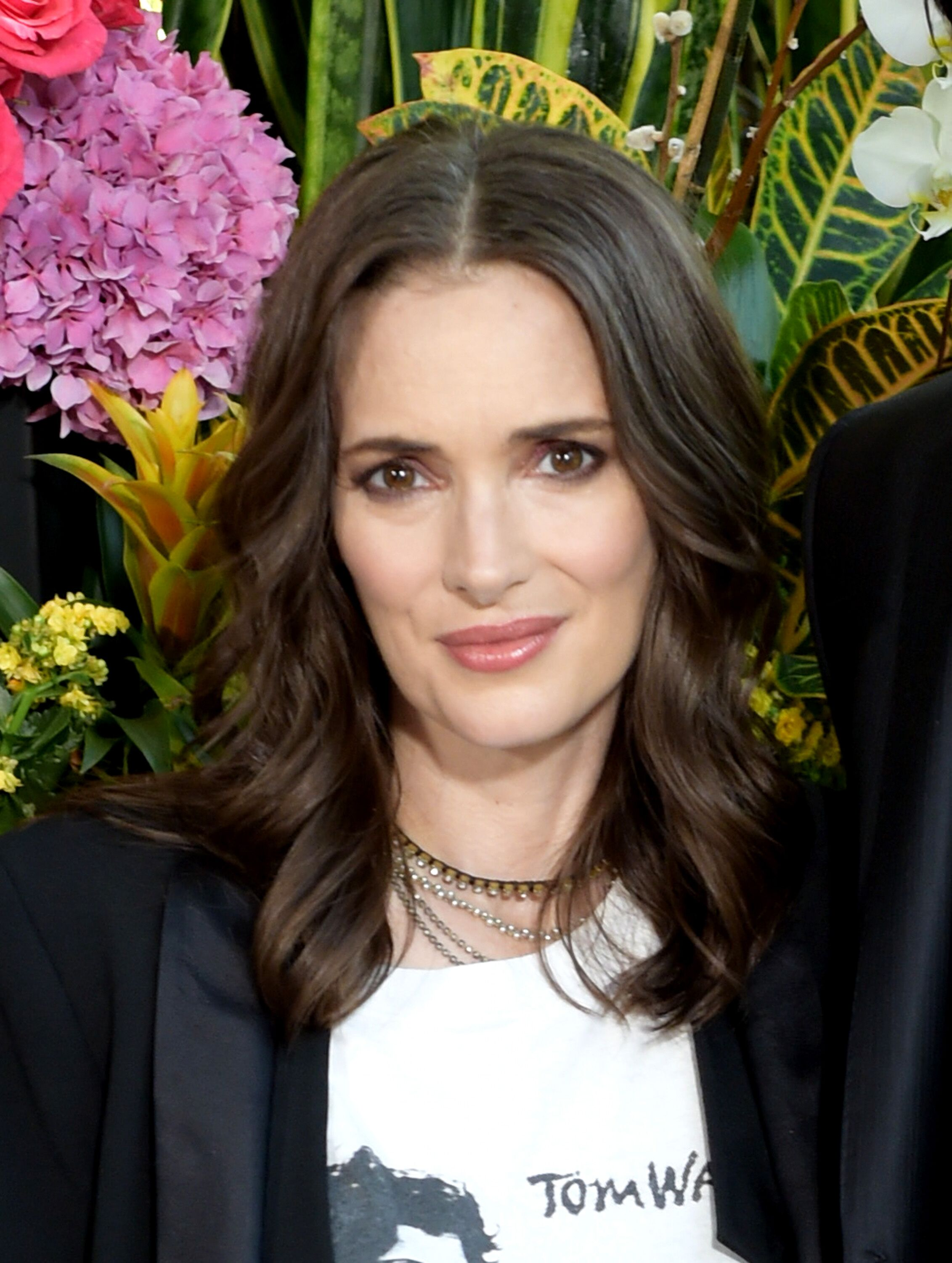 "Winona Ryder attends a photo call for Regatta's ""Destination Wedding."" 