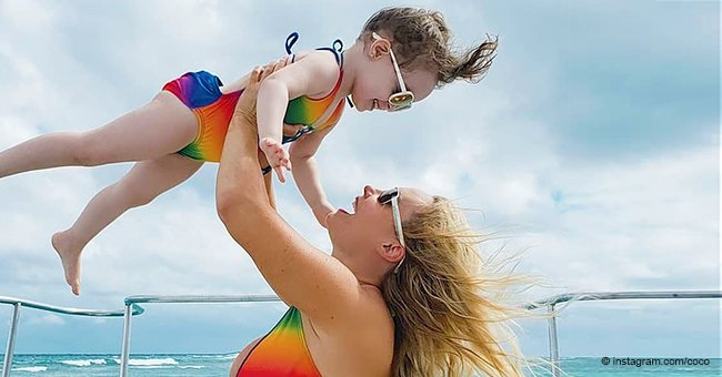 Coco Austin Lifts Her Mini-Me Daughter in the Air as They Flaunt Matching Rainbow Swimsuits