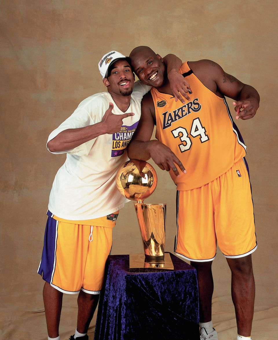 Shaquille O'Neal #34 and Kobe Bryant #8 of the Los Angeles Lakers pose for a photo after winning the NBA Championship on June 19, 2000 at the Staples Center in Los Angeles, California.   Source: Getty Images