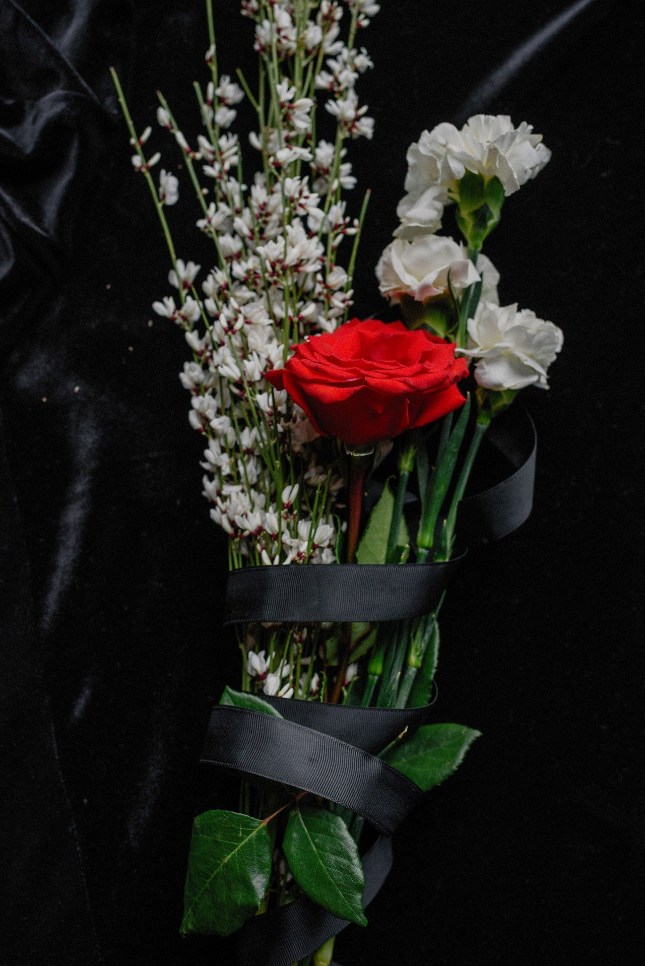 Bouquet wrapped in black paper   Source: Pexels