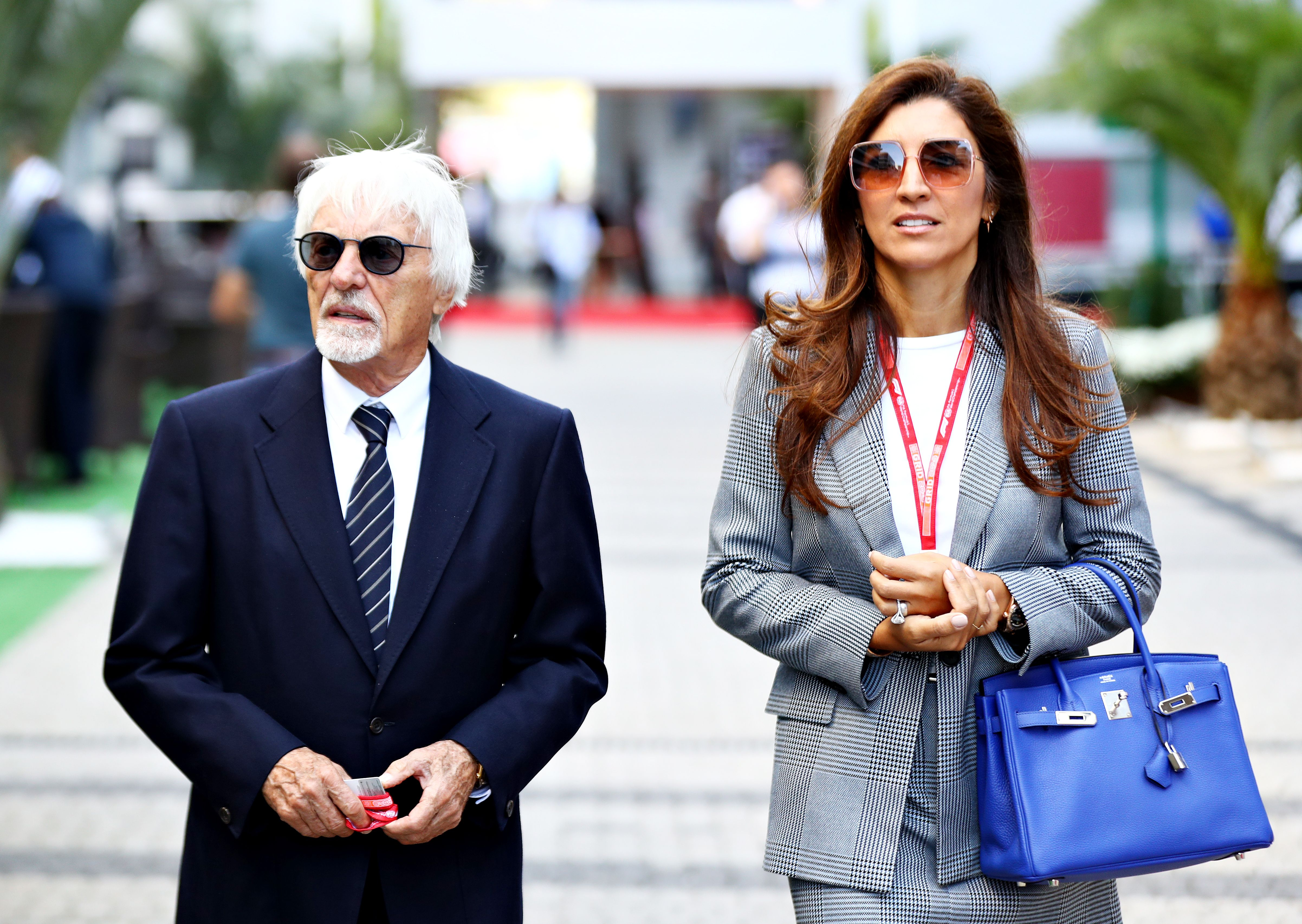 Bernie Ecclestone, Chairman Emeritus of the Formula One Group, and his wife Fabiana walk in the Paddock before the F1 Grand Prix of Russia at Sochi Autodrom on September 29, 2019 | Photo: Getty Images