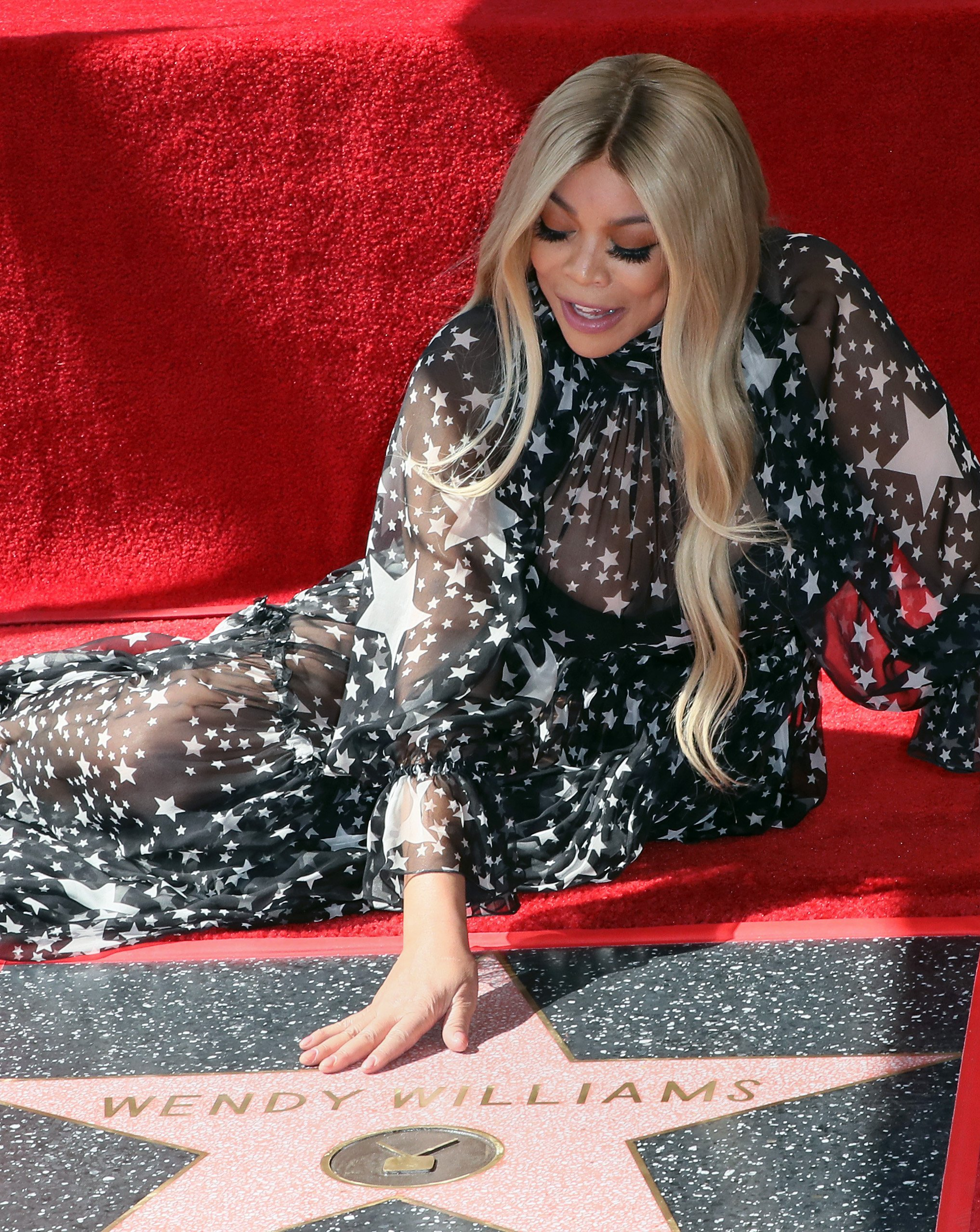 Wendy Williams marveling at her star at the Hollywood Walk of Fame. | Photo: Getty Images