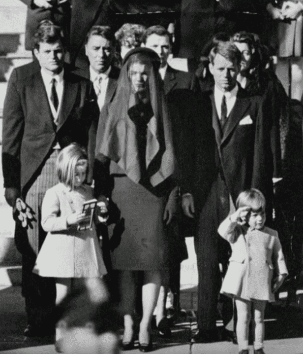 John F. Kennedy Jr. salutes his father's casket during his funeral on November 25, 1963. | Source: YouTube/CNN