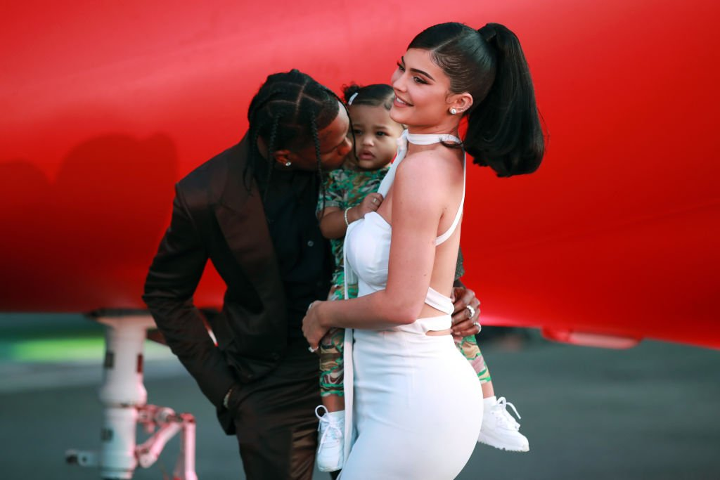 """Travis Scott, Stormi Webster, and Kylie Jenner attend the premiere of Netflix's """"Travis Scott: Look Mom I Can Fly"""" at Barker Hangar on August 27, 2019.