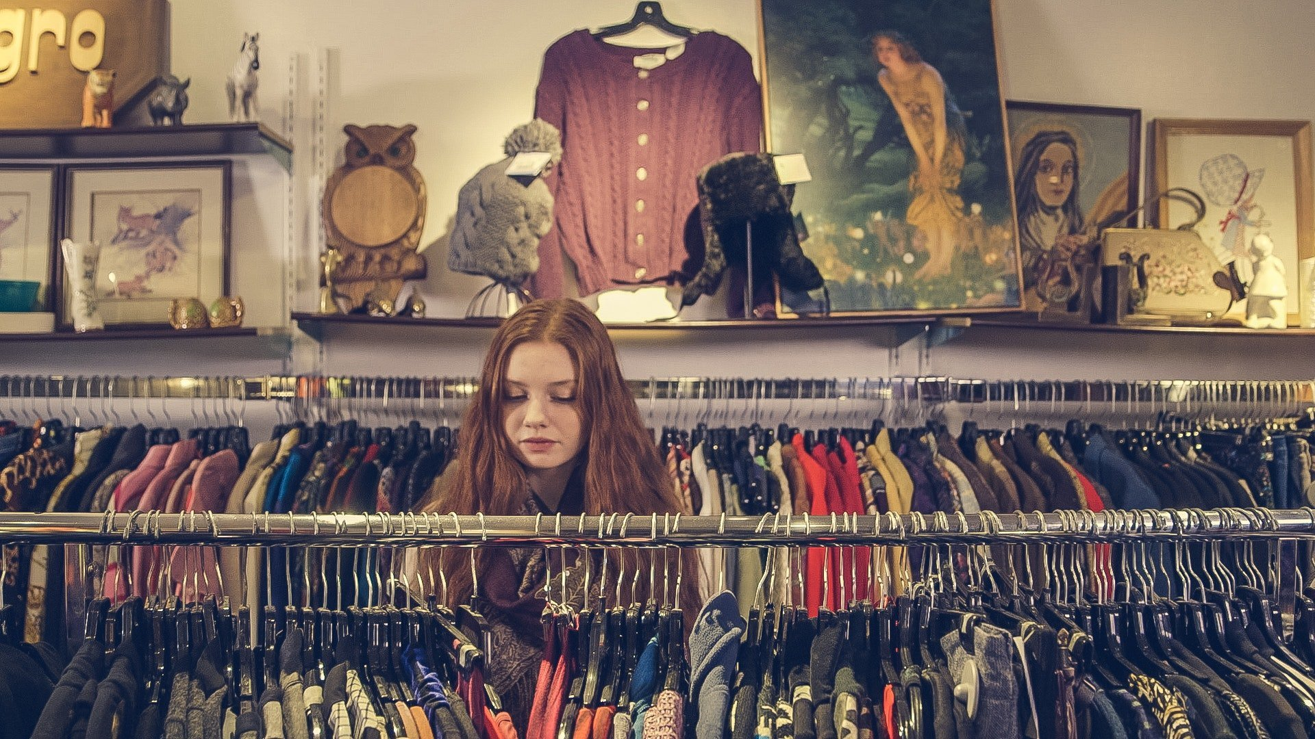 Woman shopping in a boutique store.   Source: pexels