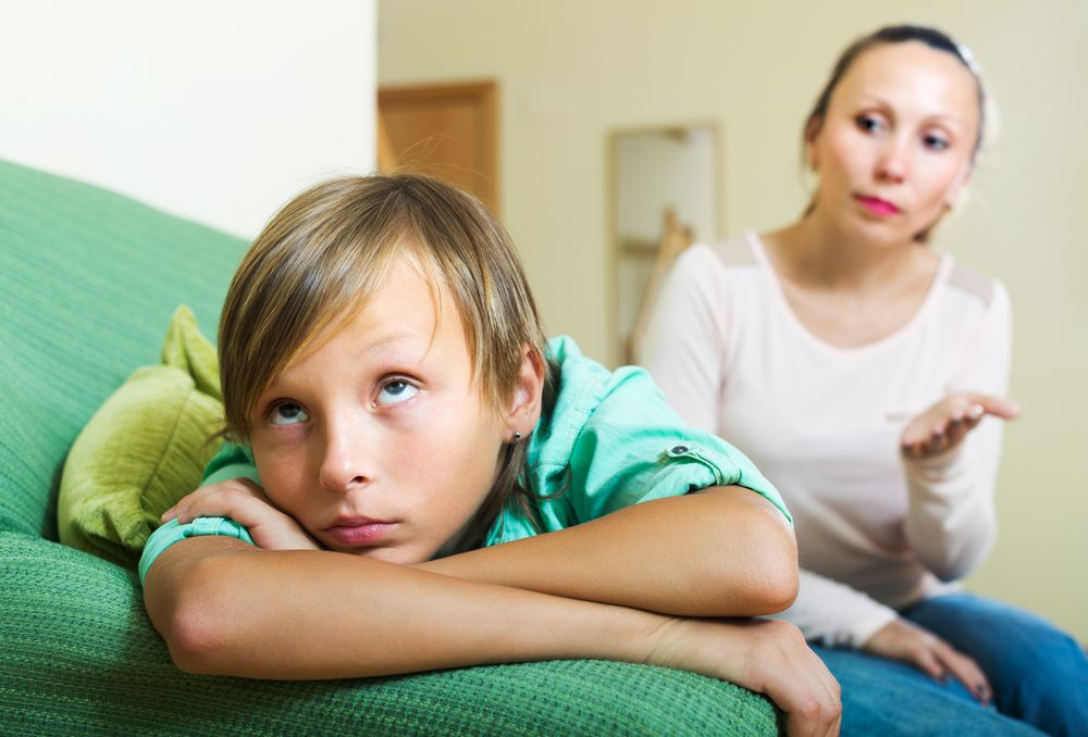 A young boy looks away while his mother talks to him.   Source: Shutterstock